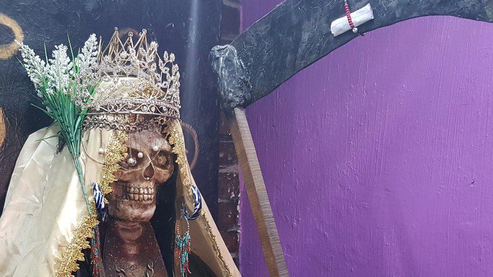 A Santa Muerte statue in the temple in Guadalajara