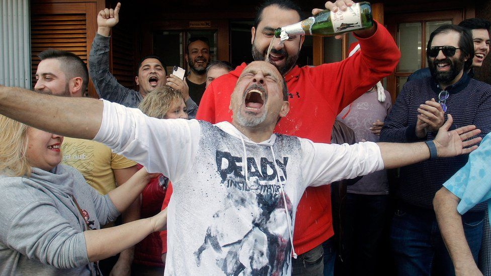 """Clients of the Restaturant """"Pepe"""" celebrate in San Vicente del Raspeig, Alicante, Spain, after winning the first prize."""