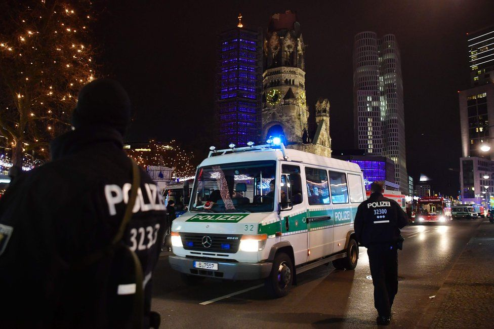 Police secure the area at the site of an accident at a Christmas market in Berlin