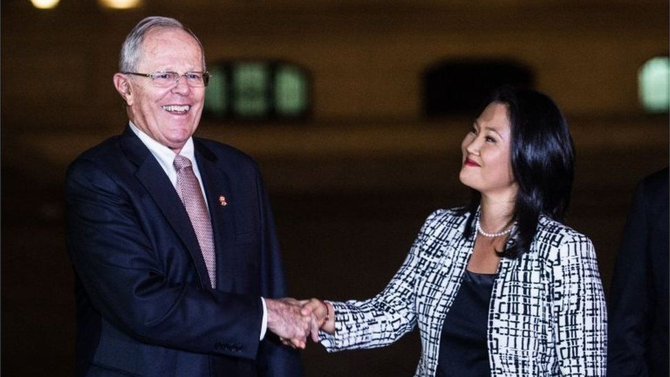 "This file picture taken on July 11, 2017 shows Peru""s President Pedro Pablo Kuczynski (2-L) shaking hands with the leader of Fuerza Popular party, Keiko Fujimori (2-R) after a private meeting at the Peruvian Governement Palace in Lima"
