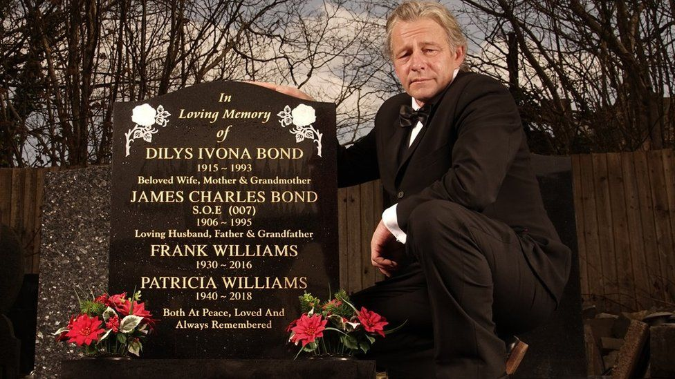 Stephen Phillips standing next to the new gravestone
