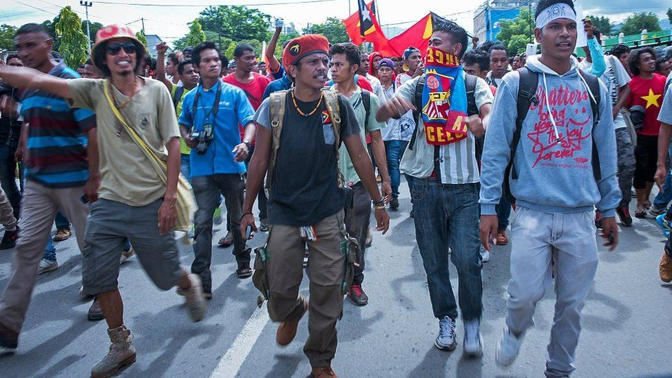East Timorese activists head toward the Australian embassy during a rally in Dili on February 23, 2016