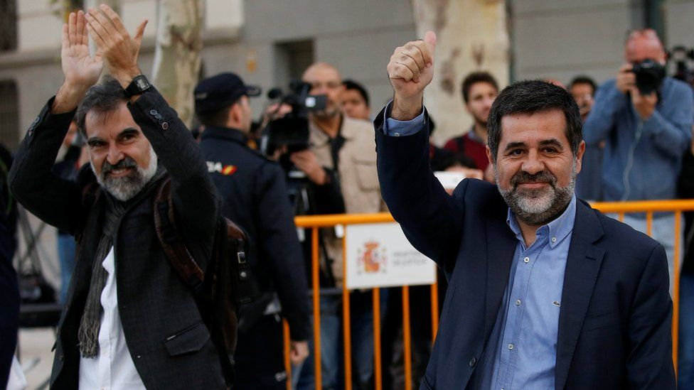 Jordi Cuixart (L), leader of Omnium Cultural, and Jordi Sanchez of the Catalan National Assembly (ANC), arrive to the High Court in Madrid, Spain, October 16, 2017