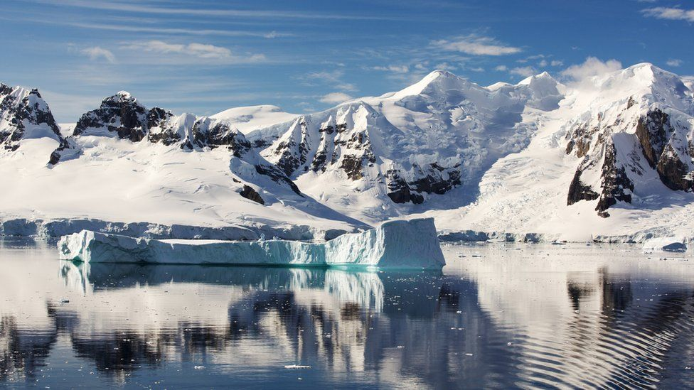Mountains and ice on sea in Antarctica