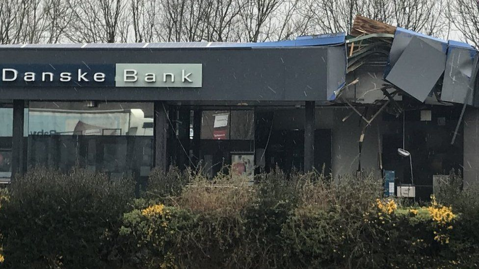 The damaged exterior of the Danske Bank branch in Newtownabbey