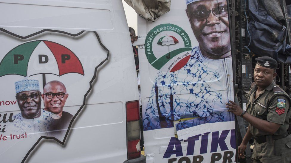 A soldier stood next to a PDP campaign van