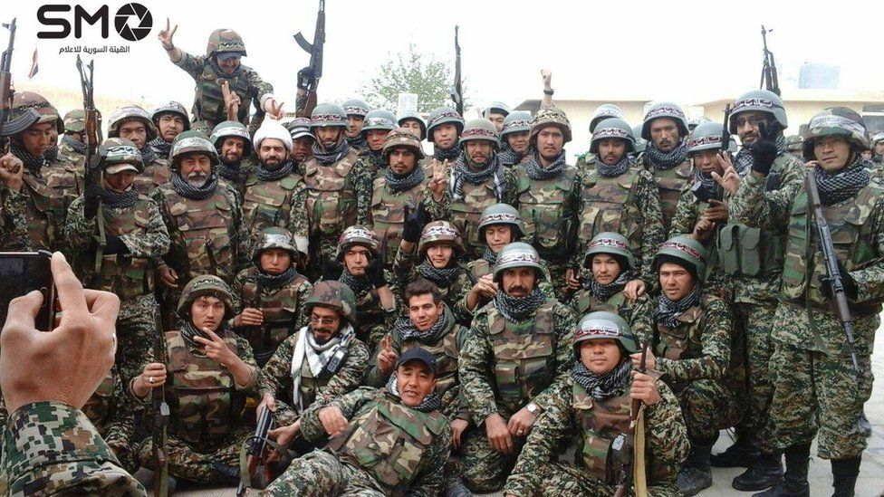 Photo obtained by opposition Syria Media Organization purportedly showing Afghan fighters in Syria