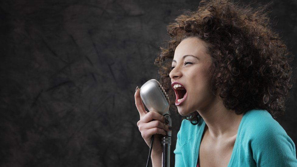 Woman shouting into microphone