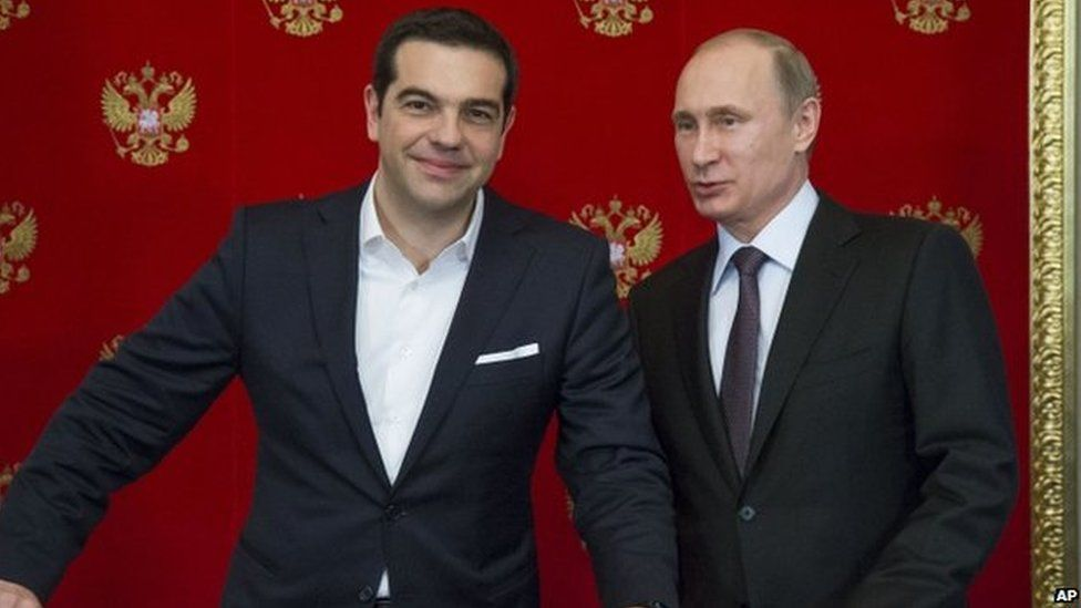 Russian President Vladimir Putin, right, and Greek Prime Minister Alexis Tsipras attend a signing ceremony in the Kremlin in Moscow, Russia