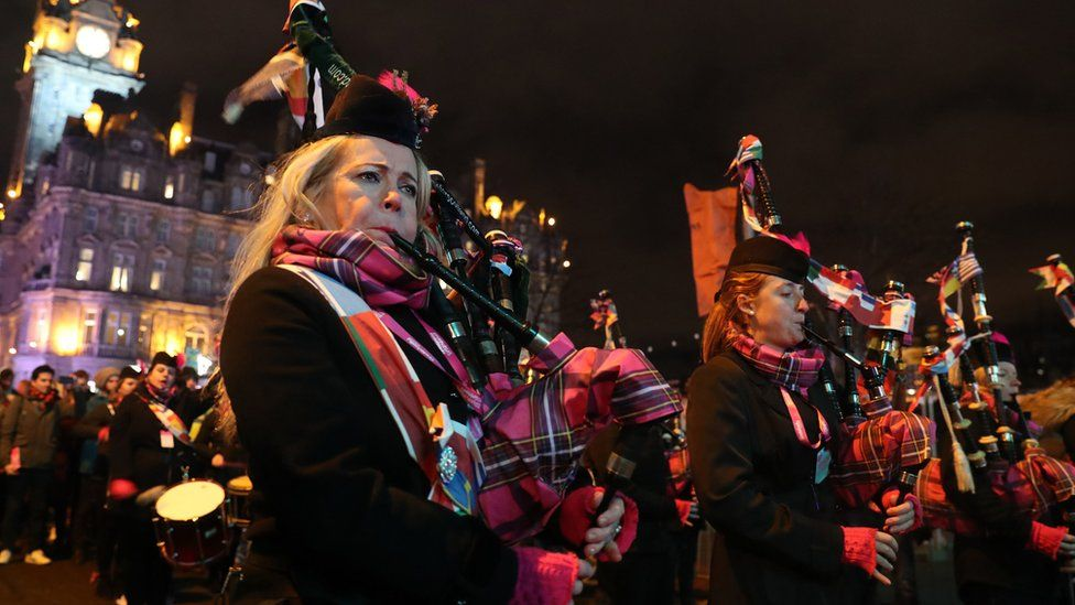 Members of the Divas and District Pipes and Drums perform on Princes Street during the Hogmanay New Year celebrations in Edinburgh