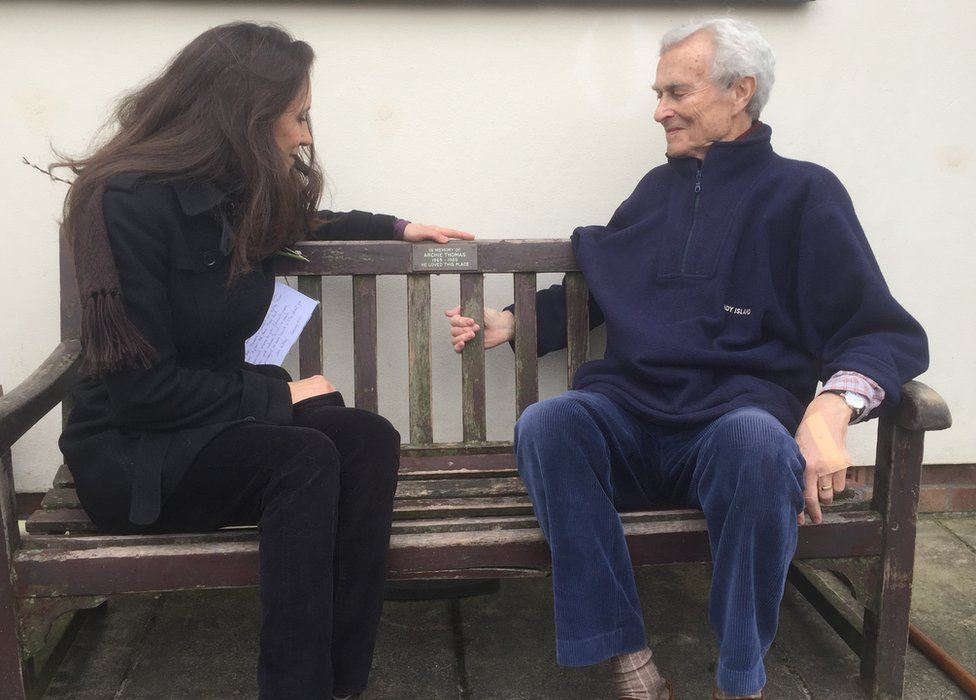 Archie Thomas' sister Emily and father Michael sitting on his memorial bench