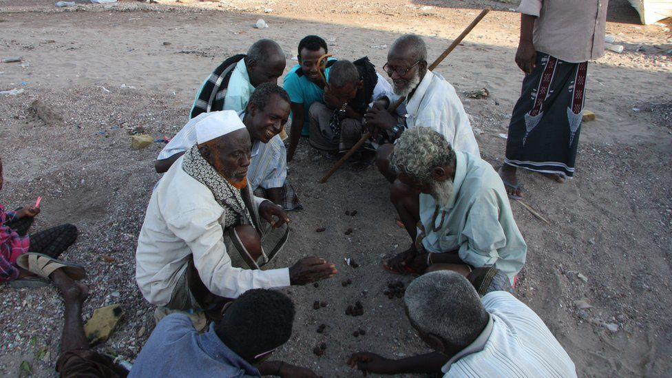 Locals playing a traditional game in Tadjoura, Djibouti