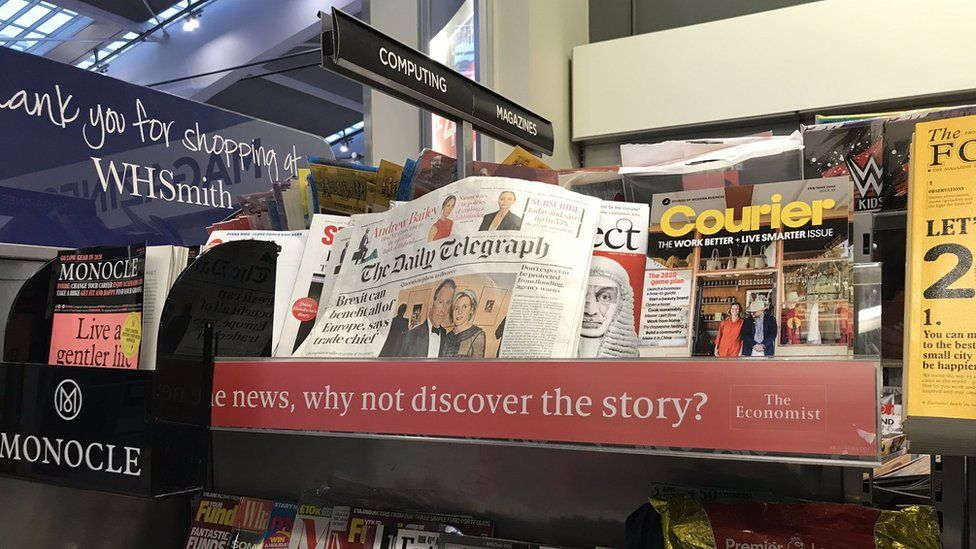 The Daily Telegraph newspaper placed with business and computing magazines in a WH Smith store