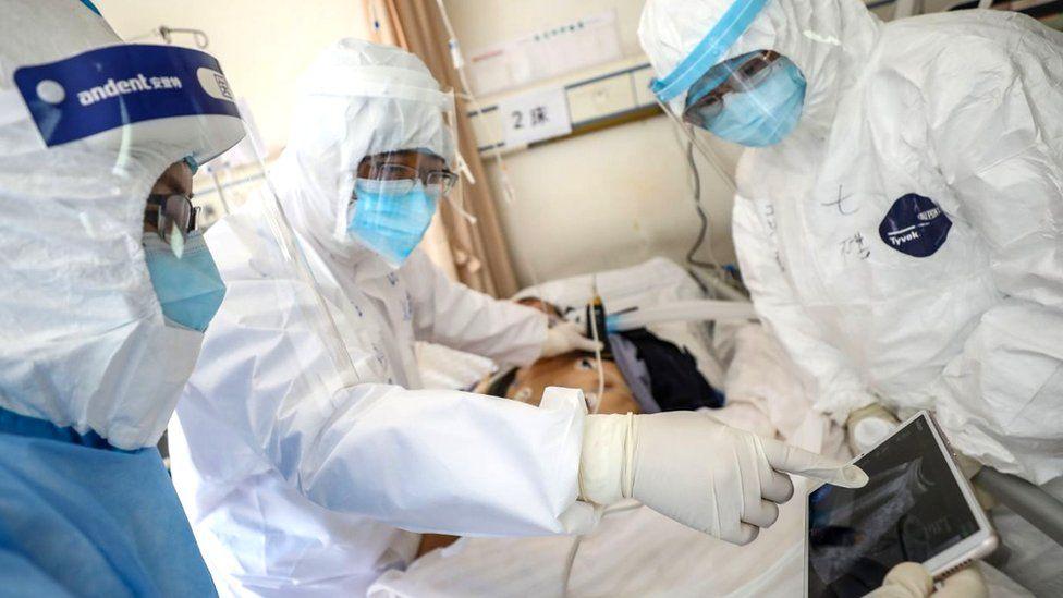 Doctors examining patient in Wuhan