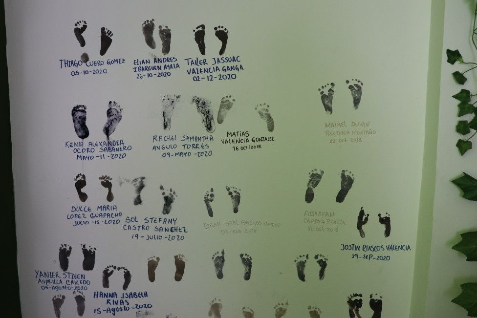 Footprints on a poster with the names of the babies the parteras have helped give birth