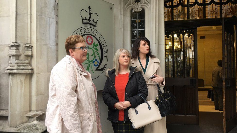 Campaigner Sarah Ewart (centre) is at the court with her supporters