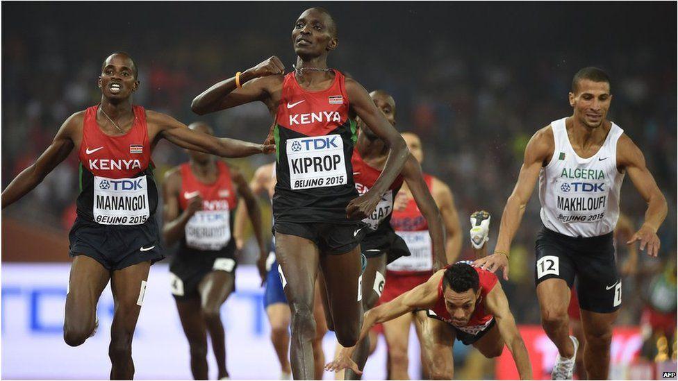Kenya's Asbel Kiprop (centre) reacts after winning the men's 1500 metre race