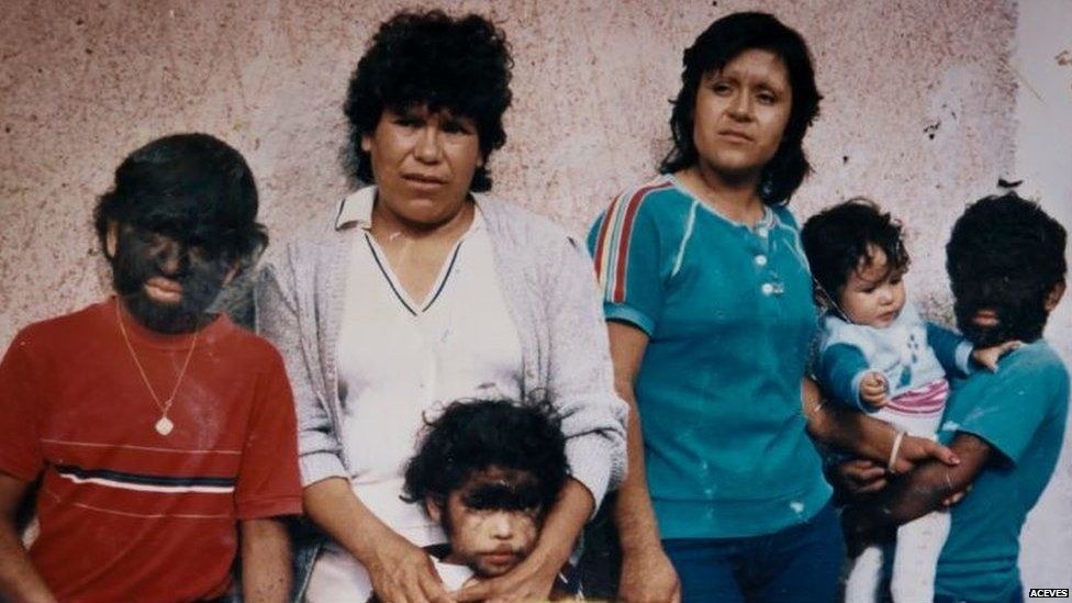 Aceves (left) as a child with his family