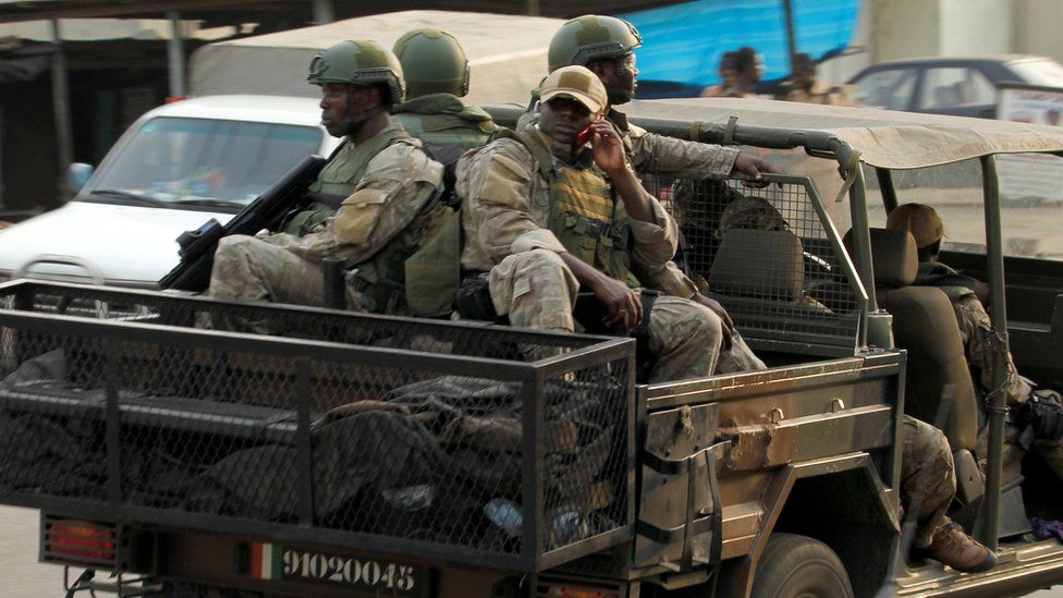Soldiers of Ivorian special forces drive through the city of Adiake, eastern Ivory Coast, February 2017