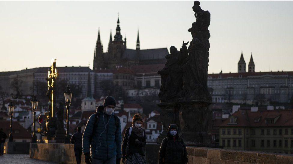 People wearing masks in Prague