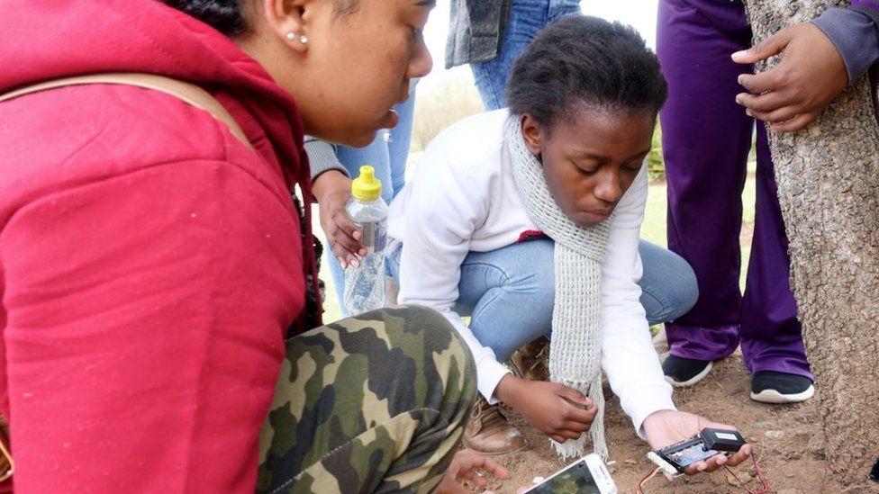 Girls testing a moisture detector