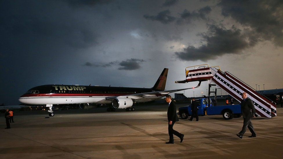 """Donald Trump""""s plane arrives at a Florida airport hanger for a rally the day after his first debate with Hillary Clinton on September 27, 2016 in Melbourne, Florida"""