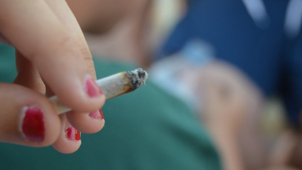 A teenager smoking cannabis