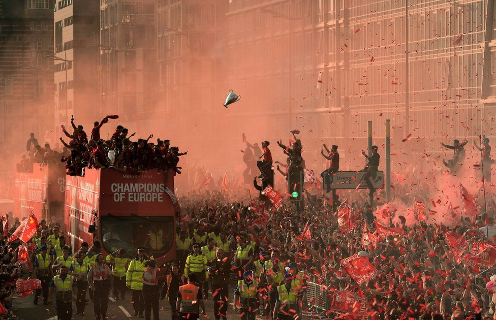 Football fans line the streets to see the Liverpool football team