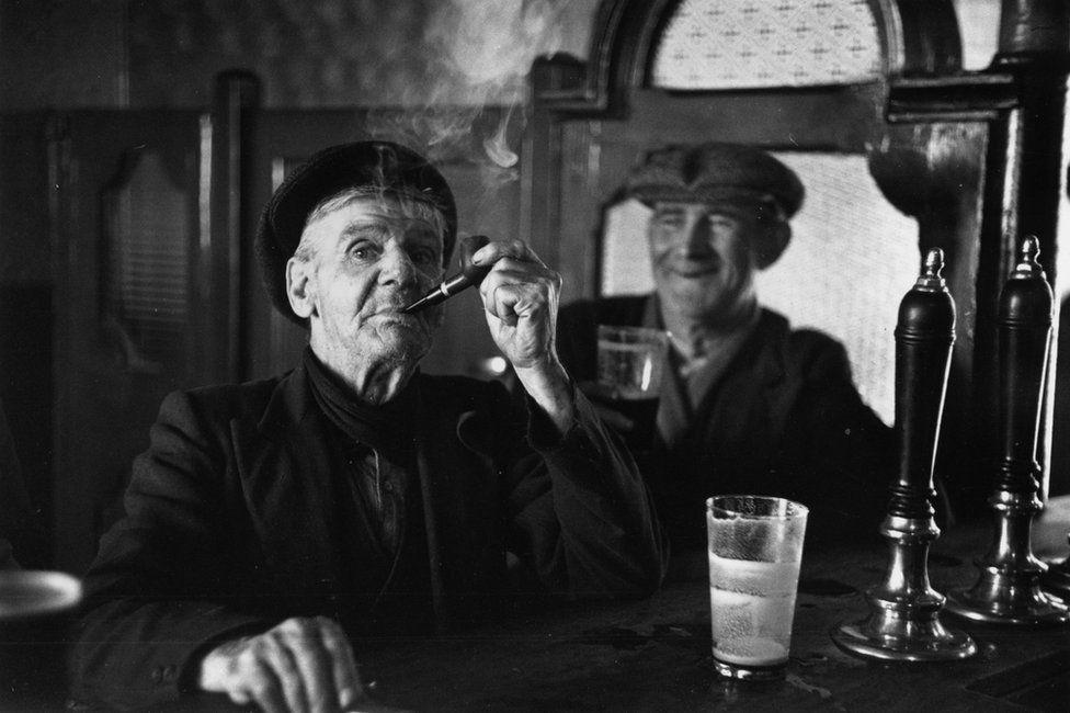 Two men in a 1950s Irish pub