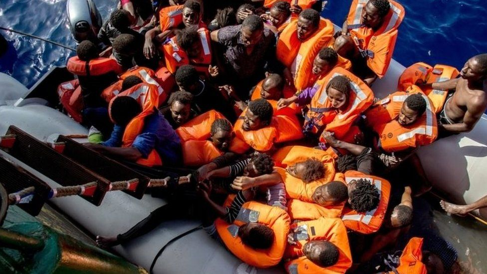 Rescued migrants board a ship during an operation co-ordinated Medecins Sans Frontieres in the Mediterranean Sea. Photo: 26 October 2016