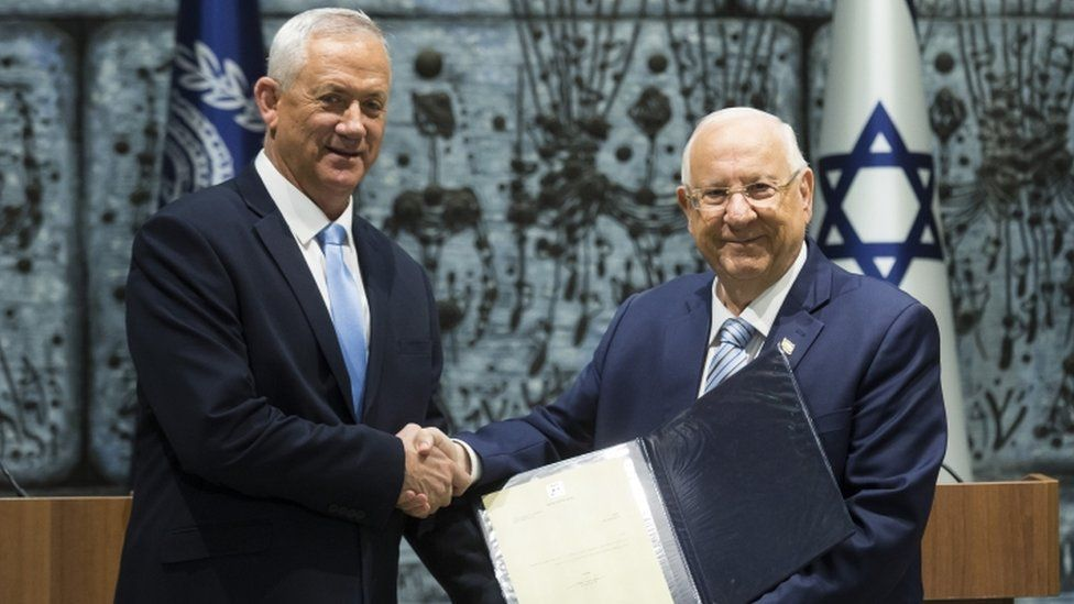 Israeli President Reuven Rivlin (R) and Blue and White Party Leader Benny Gantz attend a nomination ceremony on October 23, 2019 in Jerusalem