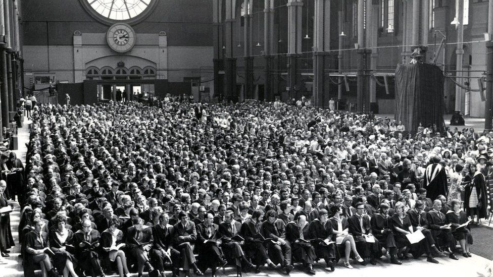 The first Open University degree ceremony held in the Great Hall of Alexandra Palace on Saturday 23 June 1973. Part of the ceremony was broadcast live on BBC2.