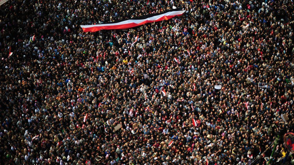 """Hundreds of thousands of Egyptian anti-government demonstrators (protestors) crowd Cairo""""s Tahrir Square on February 8, 2011 on the 15th consecutive day of protests demanding the ouster of embattled President Hosni Mubarak."""