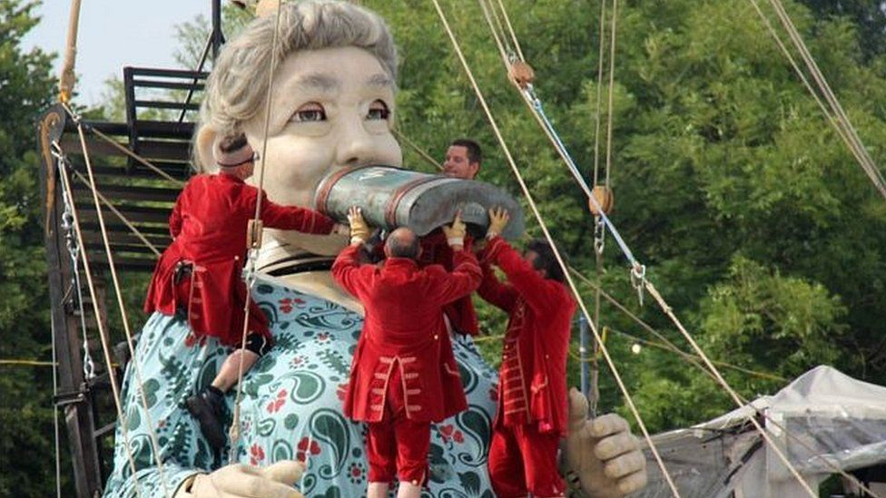 Grandmother Giant drinks from a hipflask