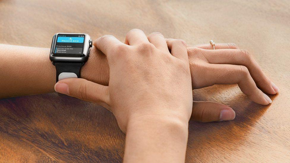 Someone wearing Kardia Band and Apple Watch