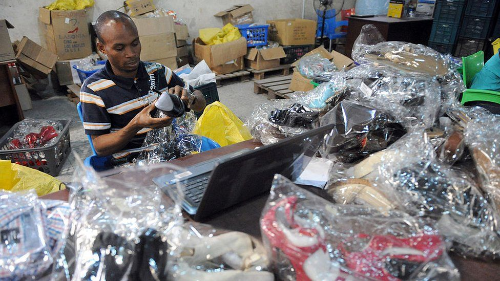 A worker scans products for delivery at the Ikeja warehouse of the company in lagos on June 12, 2013