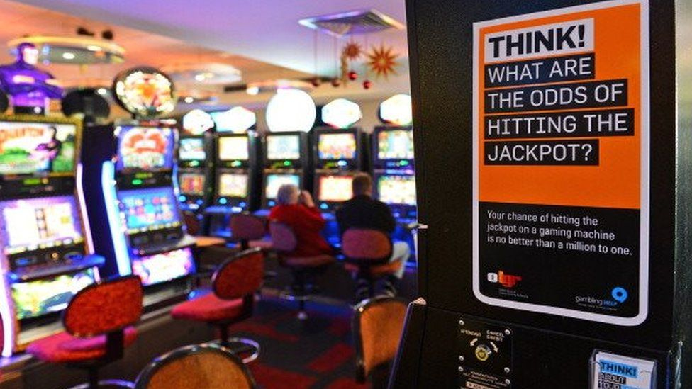 Warning sign for gamblers posted on the side of an electronic poker machine at the Randwick Labor Club in Sydney