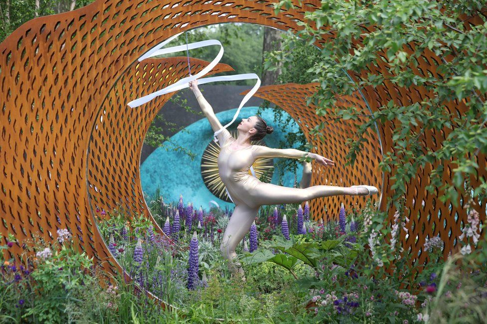 A dancer performs in the David Harber and Savills Garden at the 2018 Chelsea Flower Show
