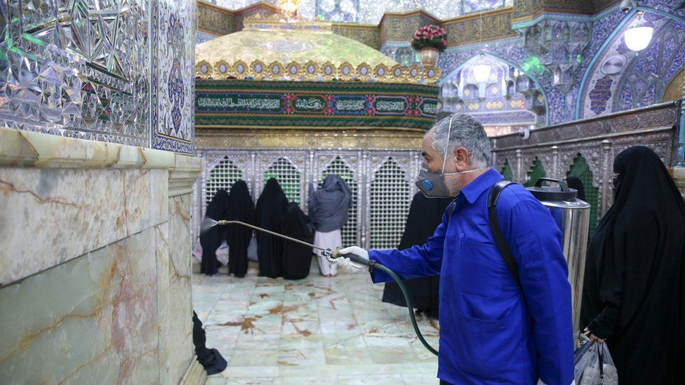 A worker disinfects the shrine of Hazrat Masumeh in Qom, Iran (25 February 2020)