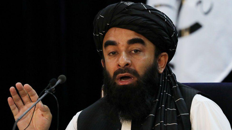 Taliban spokesman Zabihullah Mujahid announcing the new government