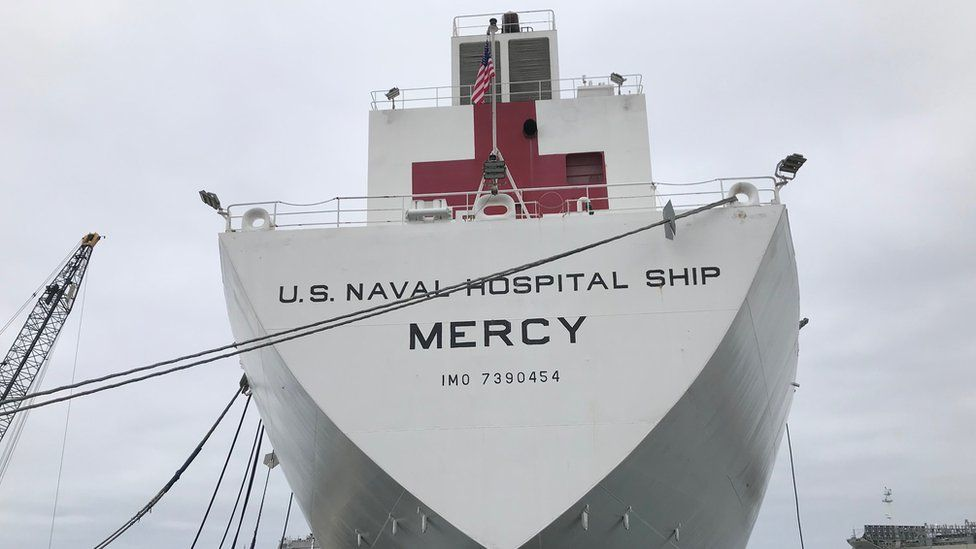 Navy ship docked near the courthouse