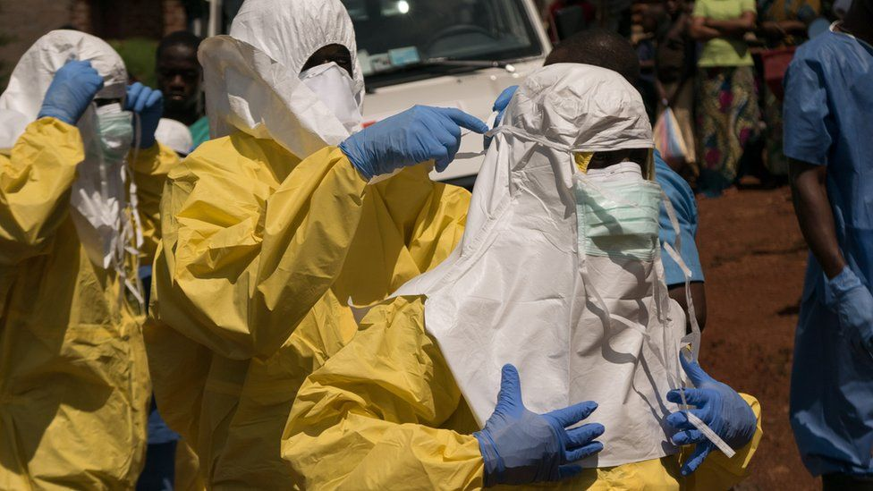 Health workers put on protective clothing