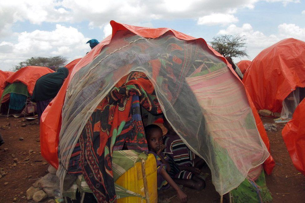 A Somali family crammed into a small tent on the outskirts of Baidoa