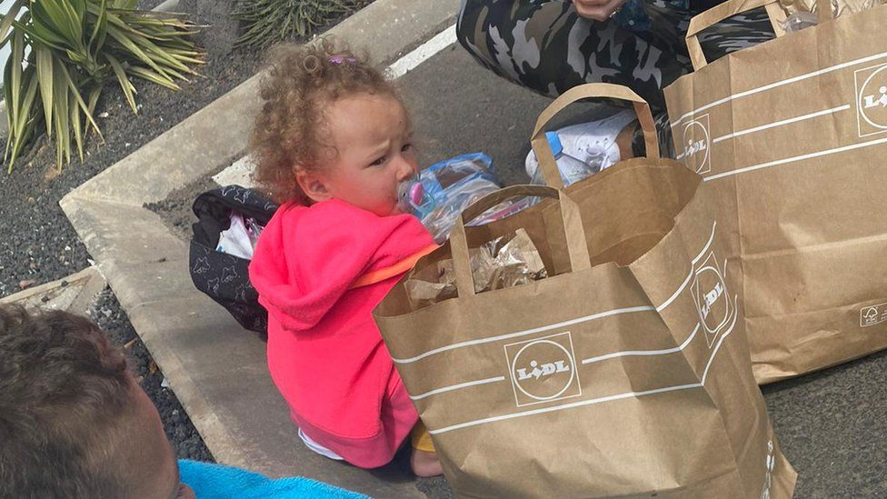 Child by bags of food