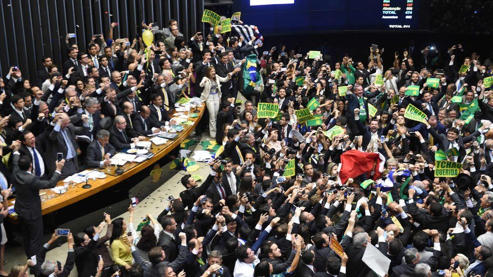 Brazil;s lawmakers celebrate after they reached the votes needed to authorize President Dilma Rousseff's impeachment to go ahead, at the Congress in Brasilia on 17 April