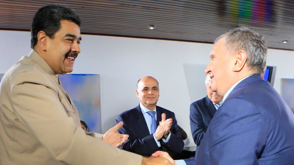 Venezuelan President Nicolás Maduro (L) greeting the head of the Russian state-owned oil giant Rosneft, Igor Sechin