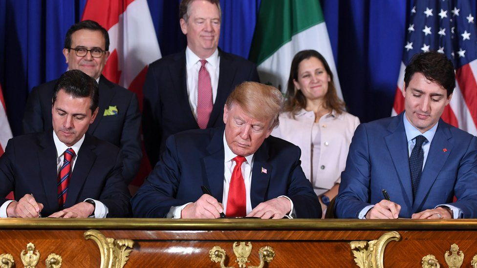 President Enrique Pena, President Donald Trump and Prime Minister Justin Trudeau sign the USMCA trade deal