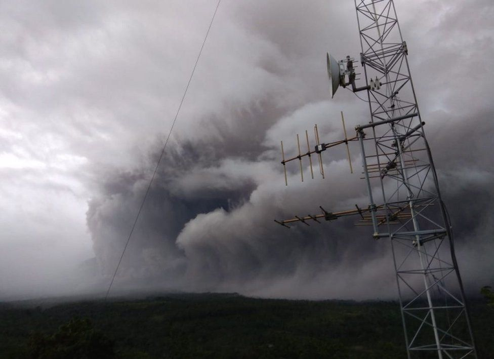 A picture from the Indonesian National Board for Disaster Management shows ash rolling over the landscape