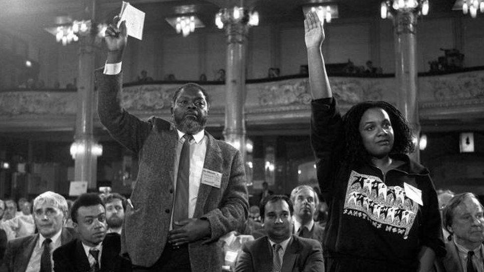 Black and white photograph of Diane Abbott raising her hand