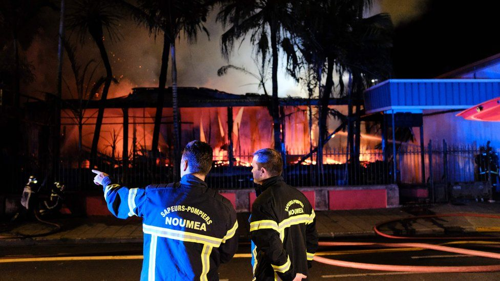 Firefighters try to extinguish a blaze in downtown Noumea on November 5, 2018